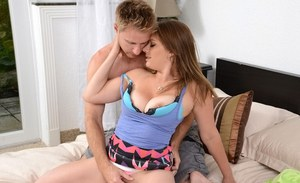 Curvy MILF Kayla West whipping out hooters during steamy sex on bed