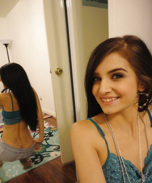Slender female Zoey Kush ditching her shorts and top while taking selfies