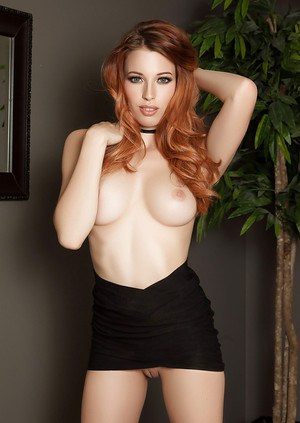 Redhead centerfold Caitlin McSwain is proud of fantastic curves of her body
