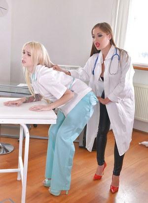 Wicked female doc digitally penetrating restrained patient as she pleases