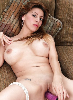 Busty older lady Valarie pleasing her pussy with large sex toy on couch