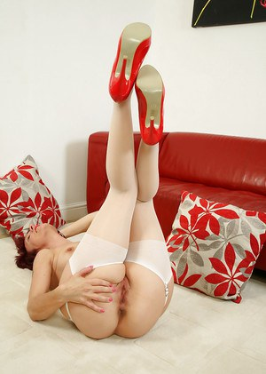 Short haired older broad Penny Brooks modeling in stockings and garters