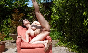Aged solo model Nikita playing with her pubic hairs on chair in backyard