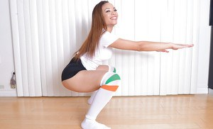 Pretty ebony female Jamie Marleigh taking off spandex shorts wearing otk socks