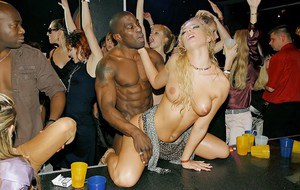 Pornstars and males strippers get together for wild groupsex action at the bar