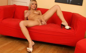 Pretty looking mature woman Lilian teases and spreads her hot pussy on a sofa