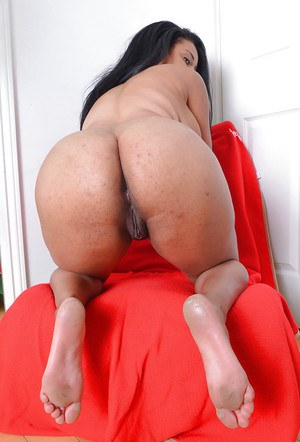 Thick Latina model Danni Lynne flashing hooters before tugging on labia lips