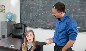Schoolgirl Dolly Leigh giving her teacher a blowjob in the classroom