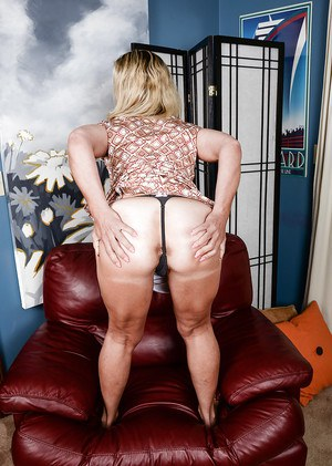 Aged blonde lady Sydney undressing and spreading her well used pussy