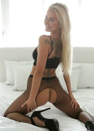 Hot blonde Aisha modeling solo wearing crotchless and assless pantyhose