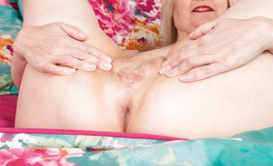 Mature fatty Emma Turner takes off panties to excite us with her pink crotch
