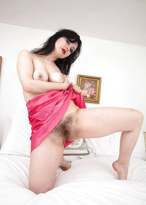 Older brunette Nikita slips off pink underwear to demonstrate all natural cunt