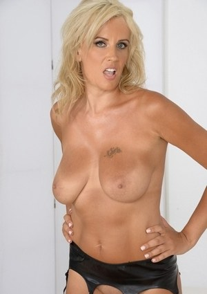 Blonde Euro mother Olga Polansky slowly taking off her clothes for nude spread