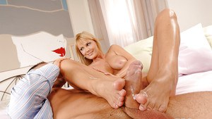 European MILF Sheila Grant gets excited by a foot job and feet licking