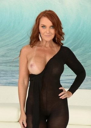 Aged redhead MILF Janet Mason removes crotchless bodystocking during hard sex