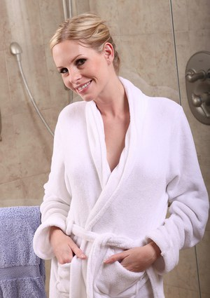 Busty blonde MILF Julie Michel wetting her trimmed pussy in shower stall