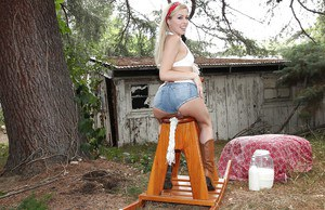 Sexy blonde Zoey Monroe slips out of denim shorts to expose pussy on the farm