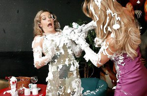 Clothed female Francesca Felucci and girlfriend cover each other in whip cream