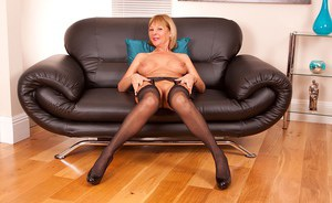 Aged solo model Elaine shows off toned body wearing black stockings and heels