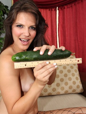 MILF in fishnet stockings Bobbi Starr swallowing an entire cucumber