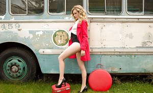 Hot blonde Olivia Preston modeling for nude centerfold shoot on old school bus