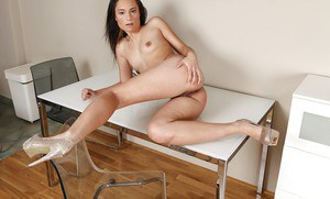 Young amateur Angie Kazdo undresses for much needed pussy masturbation on desk