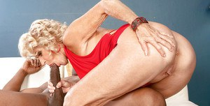 Busty blonde granny Georgette Parks sucking and fucking a big black dick