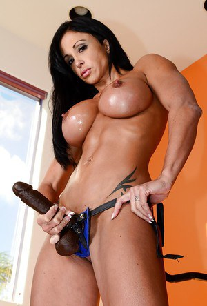 Hot bodybuilder Jewels Jade strips and affixes black strapon cock to hard body