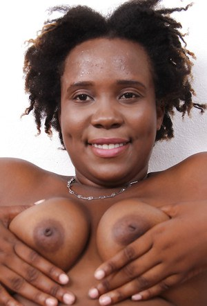 African amateur Torie Taylor strips naked and shows off her pink pussy