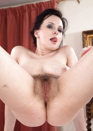 Mature solo model Nikita proudly showing off really hairy pussy