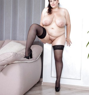 Fat solo model Mariya Mills removing nylons and lingerie to pose nude on sofa
