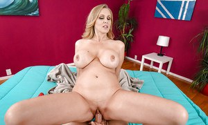 Mature mom Julia Ann changing into sexy lingerie to seduce her husband