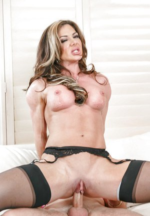 Hot cougar Nina Dolci seducing her son's best friend in skirt and nylons