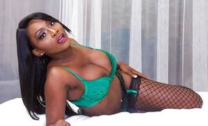 Black dime Osa Lovely modeling lingerie and fishnets before baring girl parts