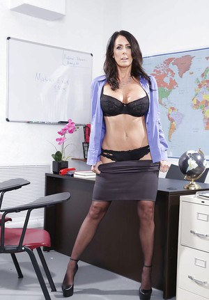 Schoolteacher Reagan Foxx strips off skirt and lingerie to pose on her desk