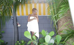 Naked Latina MILF Jazmyn caught showering outdoors by a Peeping Tom