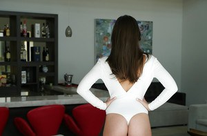 Brunette Gia Paige stads naked with a butt plug up her shaved ass