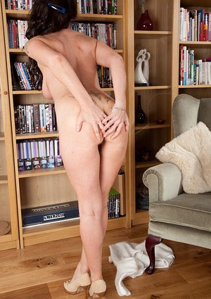 Older Euro woman Marlyn Lindsay removes lace panties to complete the nude look