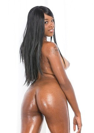 Oiled black dime Christie Sweet showing off her sexy ass and great legs
