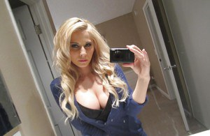 Hot blonde Madison Ivy uncovers perfect tits for self shots in bathroom mirror