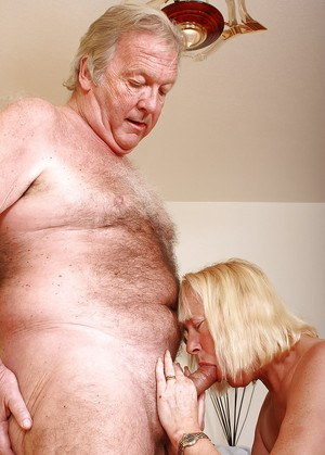 Fat older lady Angeline finishing off her hubby with handjob after sex