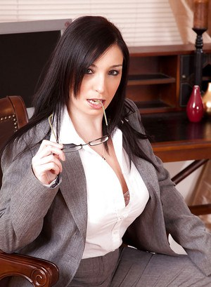 European business woman setting her hooters free in her office