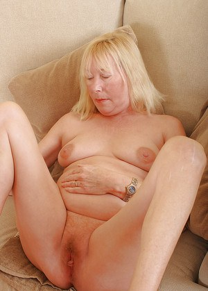 Chubby mature lady Angeline stripped naked before fucking on sofa