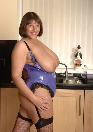 Fat older woman Sarah ditching lingerie to pose in stockings on counter top