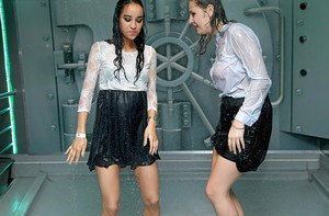 Party girls in same outfits get soaked thanks to a ship's sprinkler system