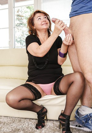 Older woman Yahra giving younger guy a much needed handjob and blowjob