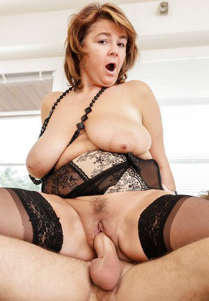 Fat mature babe in black stockings rides a young cock gets cum on big boobs
