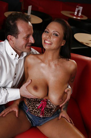 European MILF with big tits Dominno gets screwed by her lover on a red sofa