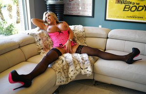 Hosuewife in a pink corset and black stockings Sandra Otterson plays a solo