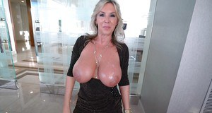 OIled up MILF Sandra Otterson rubs her huge boobs and shows them in closeup